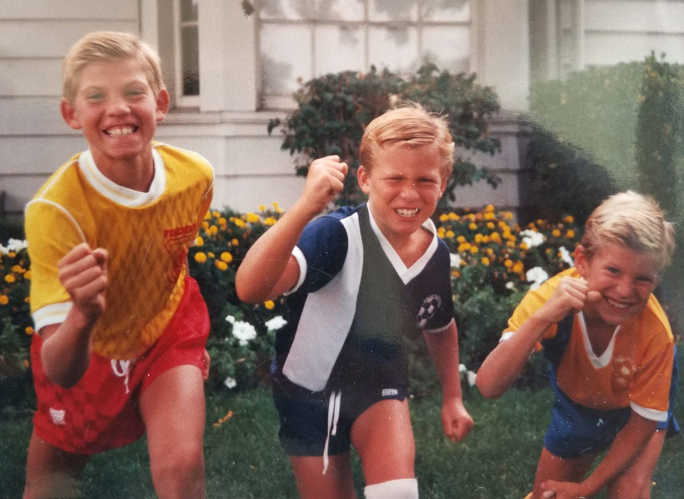 Tyler, Brannon, and Rex Patrick as kids dressed in soccer uniforms ready for action!